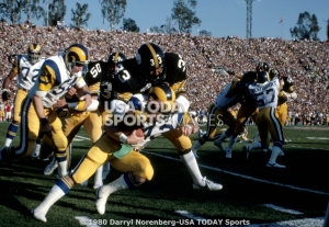 L. A. Rams db Dave Elmendorf (42) is tackled by Pittsburgh Steelers rb Anthony Anderson (33) during Super Bowl XIV
