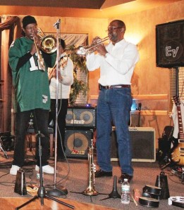 "The Raising Kane Band, ""The band with the horns!"" Scoop Kane on trombone &  Joseph Kane lll, on Trumpet."